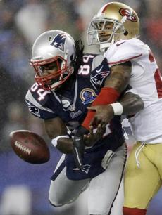 49ers cornerback Tarell Brown broke up a pass in the end zone intended for Deion Branch.